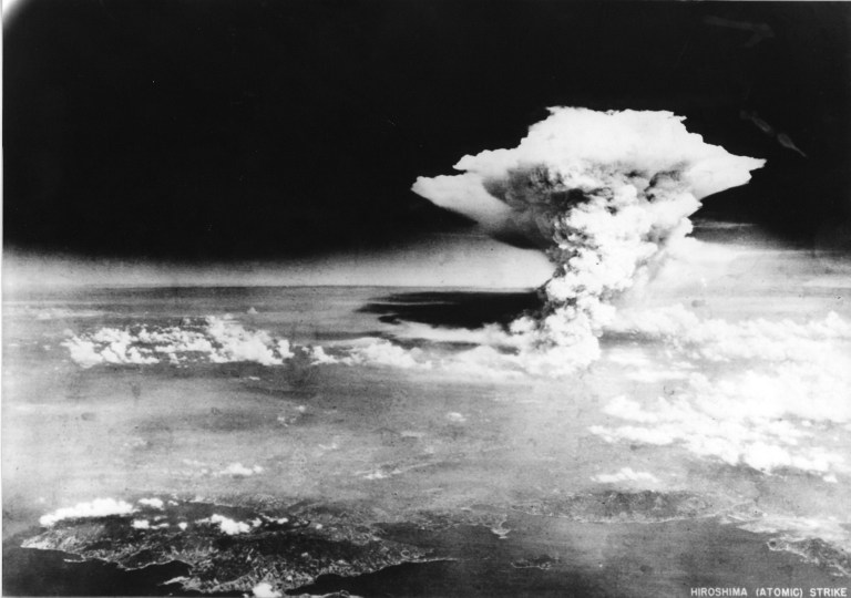 """TO GO WITH AFP STORY """"JAPAN-US-NUCLEAR-HISTORY-WWII-HIROSHIMA-ANNIVERSARY"""" BY HIROSHI HIYAMA This handout picture taken on August 6, 1945 by US Army and released from Hiroshima Peace Memorial Museum shows a mushroom cloud of the atomic bomb dropped by B-29 bomber Enola Gay over the city of Hiroshima. Charred bodies bobbed in the brackish waters that flowed through Hiroshima 70 years ago this week, after a once-vibrant Japanese city was consumed by the searing heat of the world's first nuclear attack. About 140,000 people are estimated to have been killed in the attack, including those who survived the bombing itself but died soon afterward due to severe radiation exposure.  AFP PHOTO / HIROSHIMA PEACE MEMORIAL PARK---EDITORS NOTE---HANDOUT RESTRICTED TO EDITORIAL USE - MANDATORY CREDIT """"AFP PHOTO / HIROSHIMA PEACE MEMORIAL MUSEUM"""" - NO MARKETING NO ADVERTISING CAMPAIGNS - DISTRIBUTED AS A SERVICE TO CLIENTS"""
