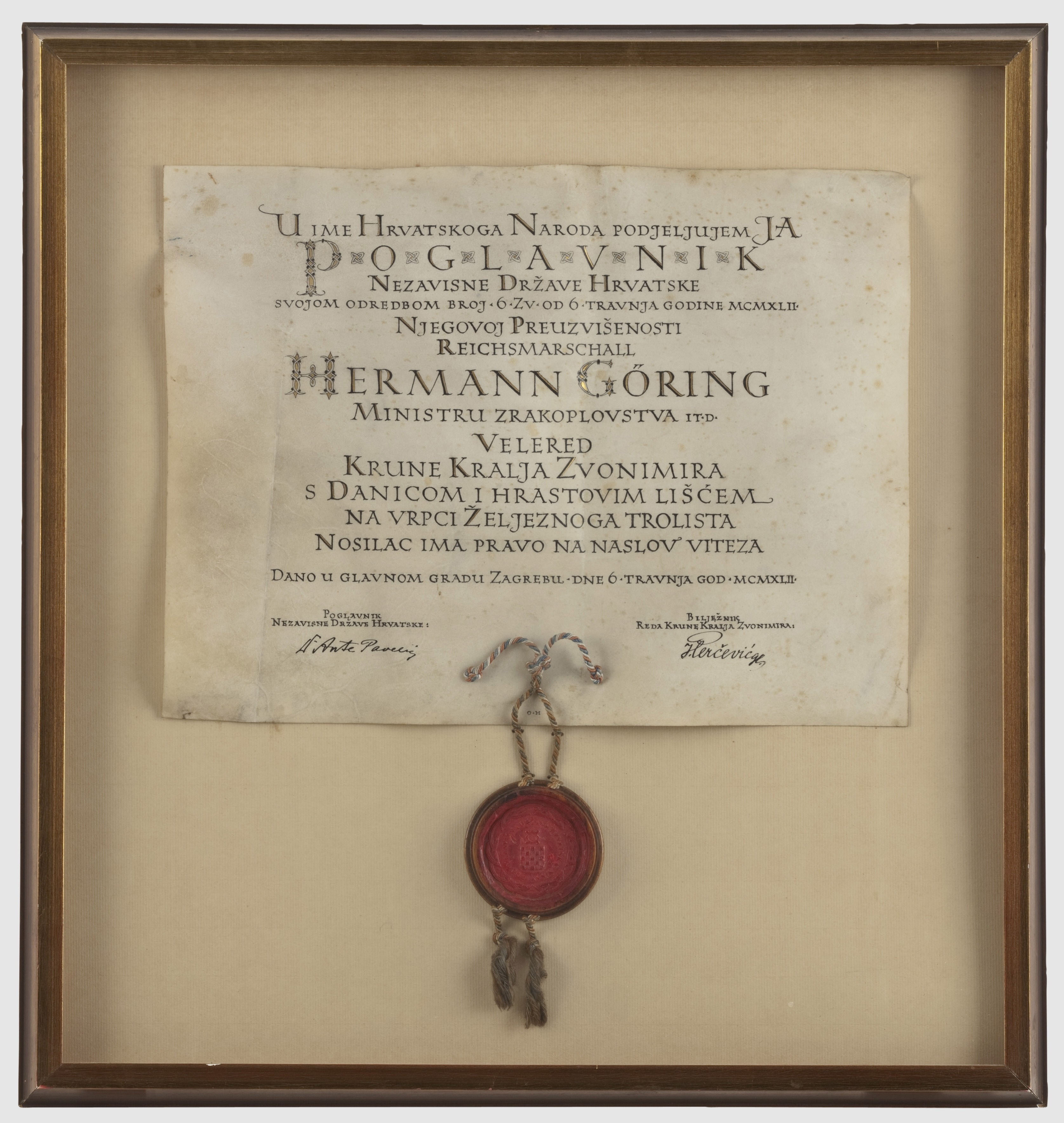 Hermann Goering, Award Document for the Grand Cross Set of the Order of the Crown of King Zvonimir with Oak Leaves Parchment with gold dÚcor and calligraphy in black India ink, the award text in Croatian dated 6 April 1942. Signed by Poglavnik Ante Pavelic and the Orders Chancellor Ivan Percevic. State seal in red wax appended to the lower edge in a wooden seal capsule (cover missing) with red-white-blue cording. Folded at one point in time, framed and under glass, 57.5 x 60 cm,, Image: 148242540, License: Rights-managed, Restrictions: , Model Release: no, Credit line: Profimedia, Alamy