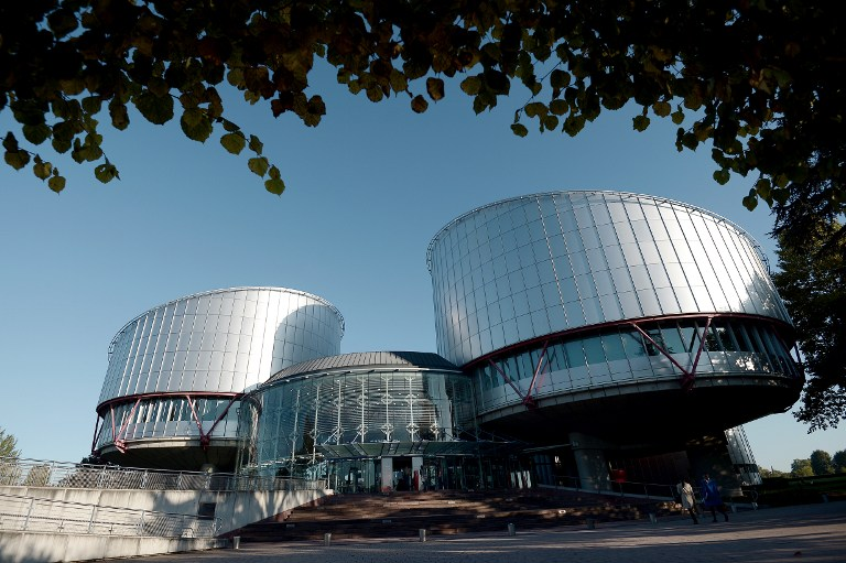 The European Court of Human Rights (ECHR) is seen during a hearing concerning the terrorist attack on a school in Beslan, North Ossetia (Russia), in September 2004, on October 14, 2014 in Strasbourg, eastern France. More than 330 hostages had been killed during the attack by pro-Chechen rebels, 186 of them were children, and about 750 people were injured. AFP PHOTO/FREDERICK FLORIN