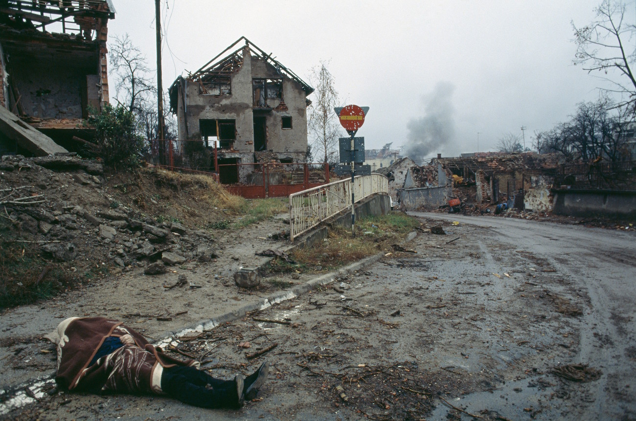 The corpse of a civilian lies in the deserted street near bombed buildings after a three-month battle between the Croatian armed forces and the Yugoslavian Federal Army in Vukovar. The Yugoslavian Federal Army completely destroyed the Croatian city and dropped 600 to 800 missiles per day, killing thousands of civilians., Image: 15114607, License: Rights-managed, Restrictions: Content available for editorial use, pre-approval required for all other uses. This content may not be materially modified or used in composite content., Model Release: no, Credit line: Profimedia, Corbis