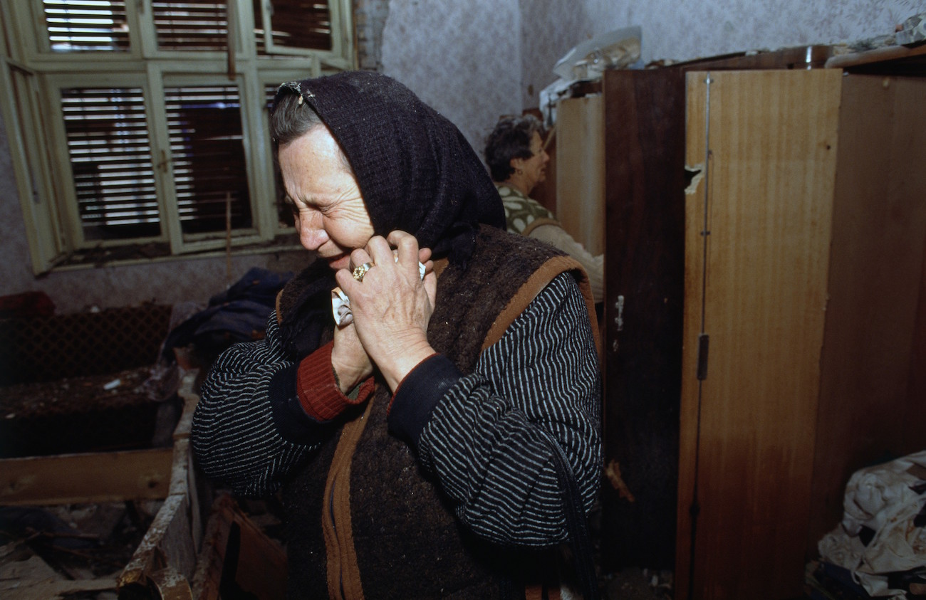 "An elderly Croatian woman who survived the three-month battle between the Croatian armed forces and the Yugoslavian Federal Army in Vukovar mourns in her damaged house. The Yugoslavian Federal Army completely destroyed the Croatian city, killing thousands of civilians, while the Serbian Volunteer Guard, formed by Zeljko ""Arkan"" Raznatovic, was responsible for massive ethnic cleansing campaigns against Bosnian Croats., Image: 15114610, License: Rights-managed, Restrictions: Content available for editorial use, pre-approval required for all other uses. This content may not be materially modified or used in composite content., Model Release: no, Credit line: Profimedia, Corbis"