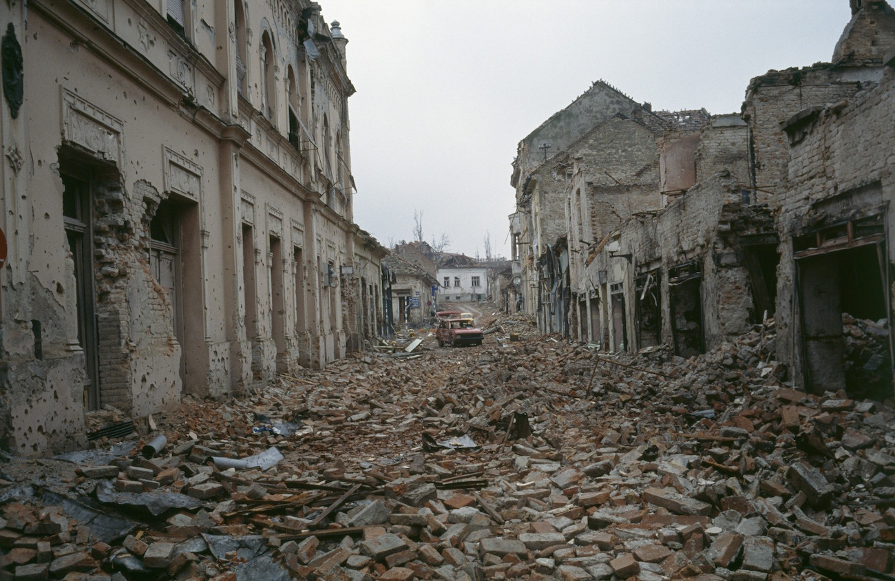 Bombed buildings are riddled with bullet holes and streets are filled with rubble after a three-month battle between the Croatian armed forces and the Yugoslavian Federal Army in Vukovar. The Yugoslavian Federal Army completely destroyed the Croatian city and killed thousands of civilians., Image: 15114616, License: Rights-managed, Restrictions: Content available for editorial use, pre-approval required for all other uses. This content may not be materially modified or used in composite content., Model Release: no, Credit line: Profimedia, Corbis