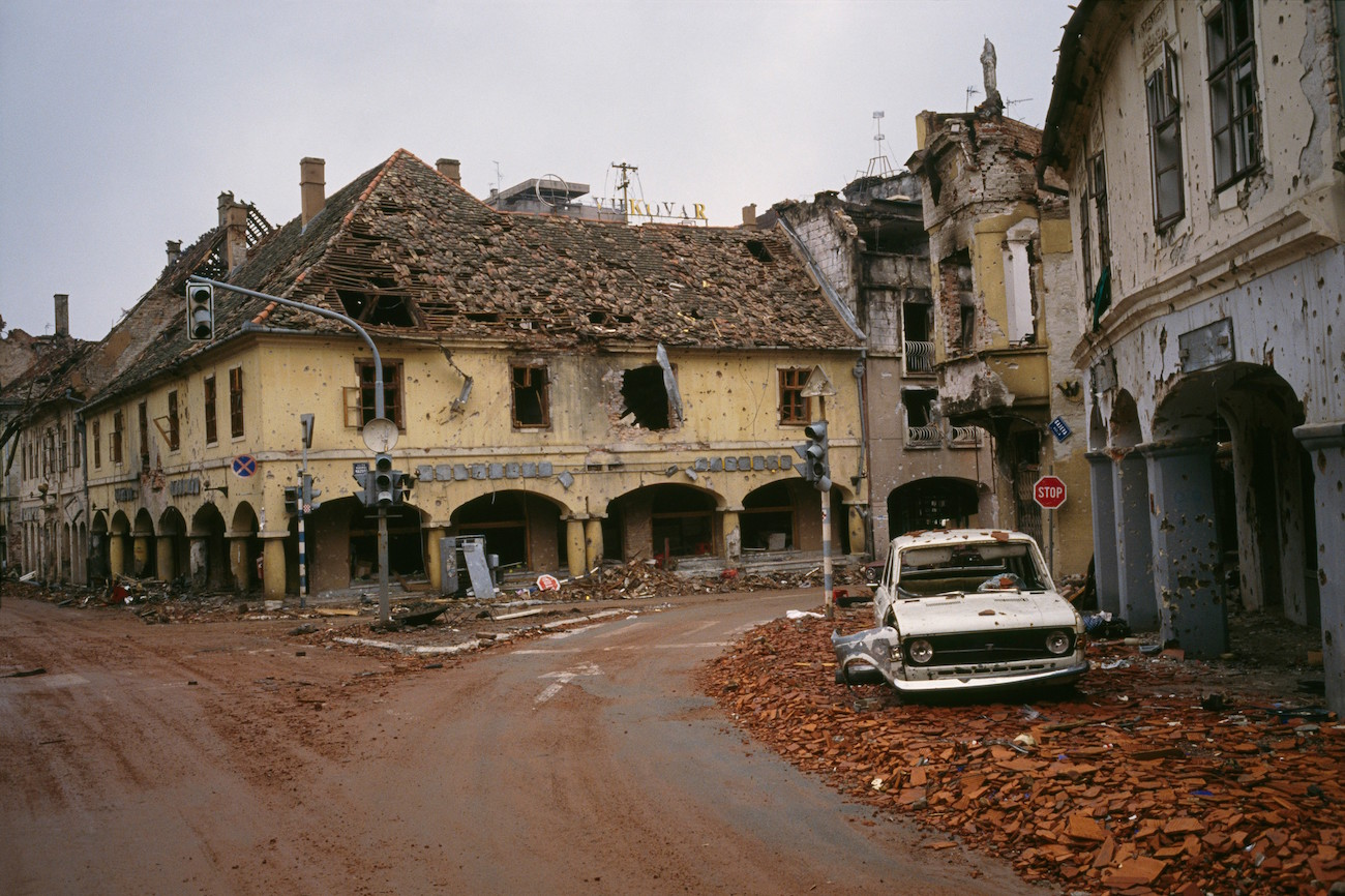 Bombed buildings are riddled with bullet holes and streets are filled with rubble after a three-month battle between the Croatian armed forces and the Yugoslavian Federal Army in Vukovar. The Yugoslavian Federal Army completely destroyed the Croatian city and killed thousands of civilians., Image: 15114628, License: Rights-managed, Restrictions: Content available for editorial use, pre-approval required for all other uses. This content may not be materially modified or used in composite content., Model Release: no, Credit line: Profimedia, Corbis