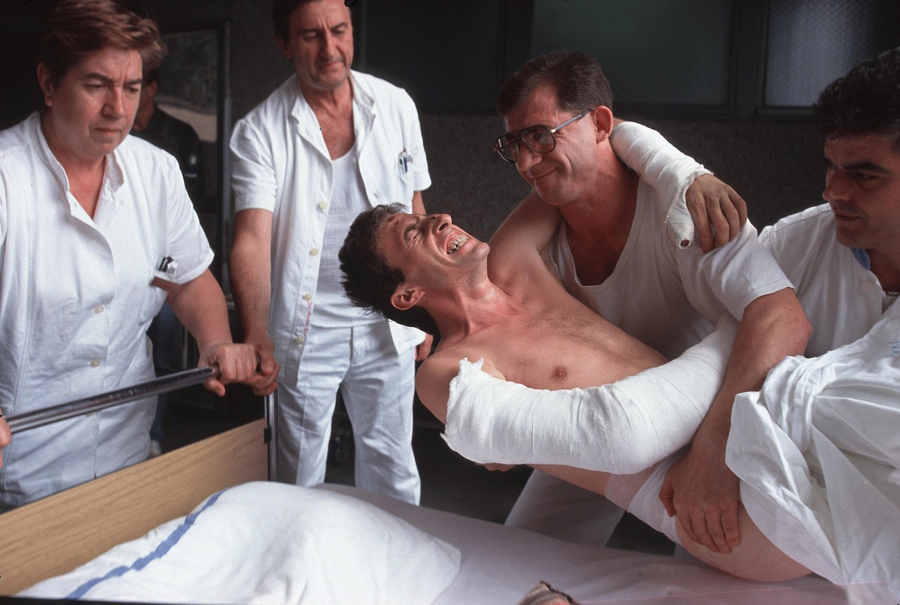 A wounded Croatian man in pain is lowered into a hospital bed in Vukovar, Croatia, which was attacked for three months by Serbian forces and was the last major city to fall before the end of the Croatian war, Aug. 29, 1991. Over 10,000 people were killed in the war between Croatia and Yugoslavia., Image: 116177654, License: Rights-managed, Restrictions: Content available for editorial use, pre-approval required for all other uses. This content not available to be downloaded through Quick Pic Not available for license and invoicing to customers located in the Czech Republic. Not available for license and invoicing to customers located in the Netherlands. Not available for license and invoicing to customers located in India. Not available for license and invoicing to customers located in Finland. Not available for license and invoicing to customers located in Italy., Model Release: no, Credit line: Profimedia, Corbis VII