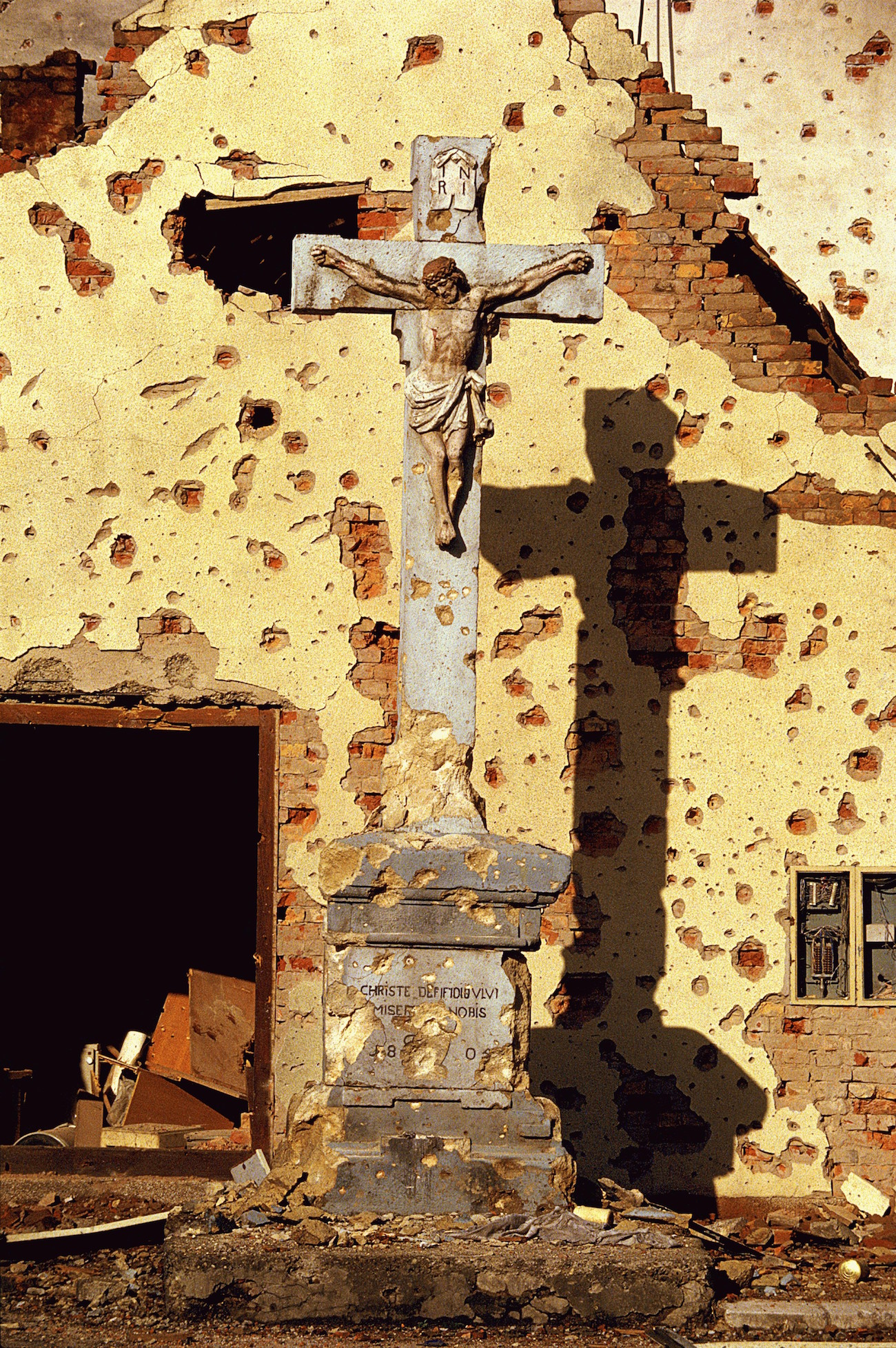 Violence and Destruction - A destroyed Roman Catholic cross in Vukovar, Croatia, Nov. 25, 1991. Vukovar was under siege for three months by Serbian forces and was completely destroyed., Image: 116177945, License: Rights-managed, Restrictions: Content available for editorial use, pre-approval required for all other uses. This content not available to be downloaded through Quick Pic Not available for license and invoicing to customers located in the Czech Republic. Not available for license and invoicing to customers located in the Netherlands. Not available for license and invoicing to customers located in India. Not available for license and invoicing to customers located in Italy. Not available for license and invoicing to customers located in Finland., Model Release: no, Credit line: Profimedia, Corbis VII