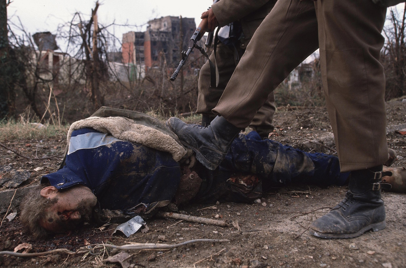 Ethnic Cleansing - Serbian soldiers and one of their victims after the fall of Vukovar, Croatia, Nov. 24, 1991. Vukovar was under siege for three months by Serbian forces and completely destroyed., Image: 116177951, License: Rights-managed, Restrictions: Content available for editorial use, pre-approval required for all other uses. This content not available to be downloaded through Quick Pic Not available for license and invoicing to customers located in the Czech Republic. Not available for license and invoicing to customers located in the Netherlands. Not available for license and invoicing to customers located in India. Not available for license and invoicing to customers located in Italy. Not available for license and invoicing to customers located in Finland., Model Release: no, Credit line: Profimedia, Corbis VII