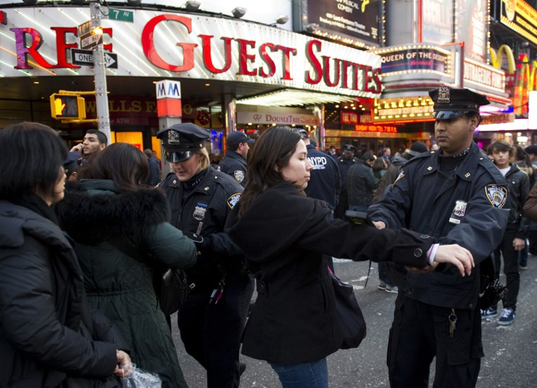 Police search people as they gather to celebrate New Year's Eve in Times Square December 31, 2011 in New York. AFP PHOTO/DON EMMERT / AFP / DON EMMERT