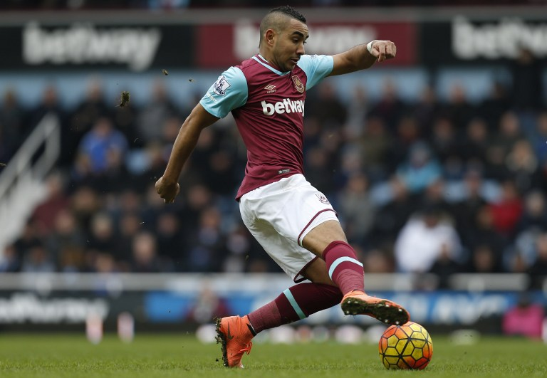 West Ham United's French midfielder Dimitri Payet runs with the ball during the English Premier League football match between West Ham United and Sunderland at The Boleyn Ground in Upton Park, in east London on February 27, 2016. West Ham won the game 1-0. / AFP / IAN KINGTON / RESTRICTED TO EDITORIAL USE. No use with unauthorized audio, video, data, fixture lists, club/league logos or 'live' services. Online in-match use limited to 75 images, no video emulation. No use in betting, games or single club/league/player publications. /