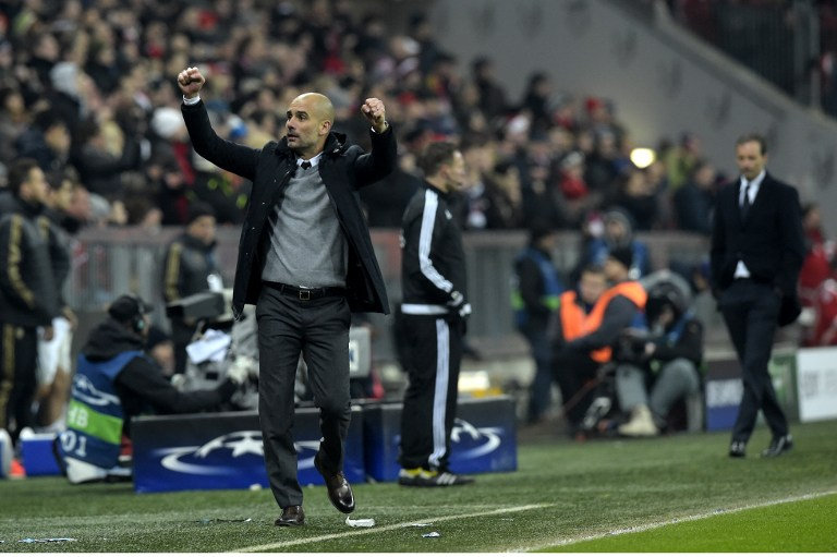 Bayern Munich's Spanish head coach Pep Guardiola (L) celebrates his team's victory next to Juventus' coach from Italy Massimiliano Allegri (R) after the extra time of the UEFA Champions League, Round of 16, second leg football match FC Bayern Munich v Juventus in Munich, southern Germany on March 16, 2016. Bayern Munich won 4-2 and qualified for the quarter finals. / AFP / TOBIAS SCHWARZ