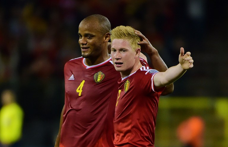 Belgium's Kevin De Bruyne (R) celebrates after scoring with Belgium's Vincent Kompany during the Euro 2016 qualifying match between Belgium and Bosnia and Herzegovina at the King Baudouin Stadium in Brussels, on September 3, 2015. AFP PHOTO / EMMANUEL DUNAND / AFP / EMMANUEL DUNAND
