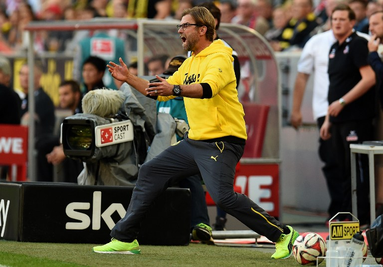 Dortmund's head coach Juergen Klopp reacts during the German First division Bundesliga football match 1 FC Koeln vs Borussia Dortmund on October 18, 2014 in Cologne, western Germany. AFP PHOTO / PATRIK STOLLARZ DFL RULES TO LIMIT THE ONLINE USAGE DURING MATCH TIME TO 15 PICTURES PER MATCH. IMAGE SEQUENCES TO SIMULATE VIDEO IS NOT ALLOWED AT ANY TIME. FOR FURTHER QUERIES PLEASE CONTACT DFL DIRECTLY AT + 49 69 650050. / AFP PHOTO / PATRIK STOLLARZ