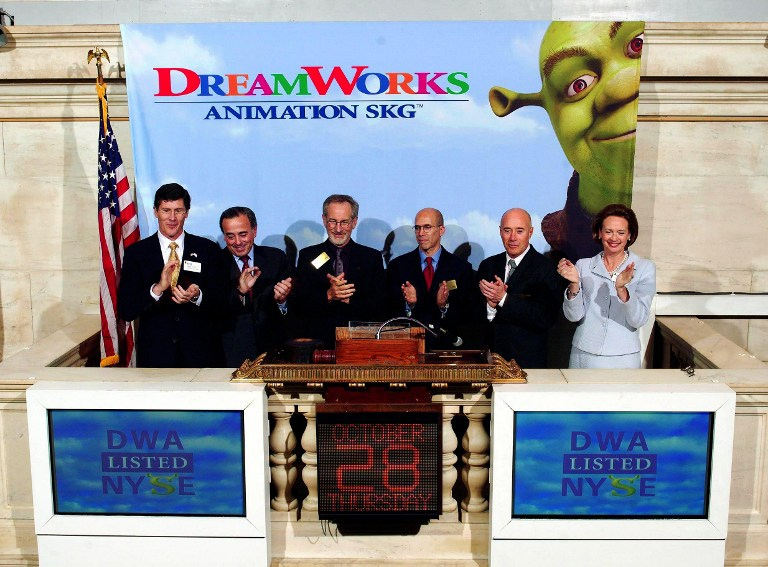 This photo released by the New York Stock Exchange (NYSE) 28 October, 2004, shows (L-R) John Thain, NYSE chief executive officer; Roger Enrico, DreamWorks executive chairman ; Steven Spielberg, co-founder; Jeffrey Katzenberg, chief executive officer and director; David Geffen, co founder; and Catherine Kinney, NYSE president applauding after the opening bell introducing the public offering of DreamWorks at the exchange podium in New York 28 October. The animation company behind the blockbuster Shrek movies enjoyed a fairytale beginning on Wall Street as its shares price leapt by more than a third. Shares soared a 9.65 USD, or 34.46 percent, to 37.65 USD by late morning. The Glendale, California-based producer of computer-generated animation films had distributed 29 million shares to the public at an initial price of 28 USD, raising 812 million USD. AFP PHOTO/NYSE / AFP PHOTO / NYSE