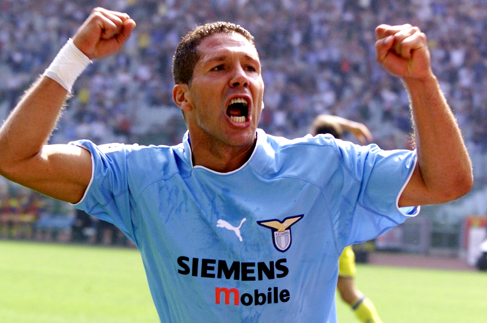 Lazio's Argentine midfielder Diego Simeone celebrates after scoring the first goal for his team during Italian major league soccer match against Chievo at the Olympic stadium in Rome Sunday, Sept. 15, 2002. Chievo won 3-2. (AP Photo/Giuseppe Calzuola)