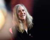 US singer Patti Smith gives an interview on December 3, 2015 in Paris, within the United Nations conference on climate change , or COP21. / AFP PHOTO / LOIC VENANCE
