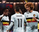Belgium's forward Yannick Ferreira-Carrasco (C) celebrates with Belgium's forward Michy Batshuayi (L) and Belgium's midfielder Marouane Fellaini (R) after scoring his team's fourth goal  during the Euro 2016 round of 16 football match between Hungary and Belgium at the Stadium Municipal in Toulouse on June 26, 2016.   / AFP PHOTO / PASCAL GUYOT
