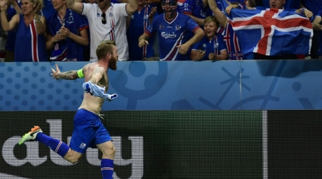 Iceland's midfielder Aron Gunnarsson celebrates the team's 2-1 win over England in the Euro 2016 round of 16 football match between England and Iceland at the Allianz Riviera stadium in Nice on June 27, 2016.   / AFP PHOTO / TOBIAS SCHWARZ