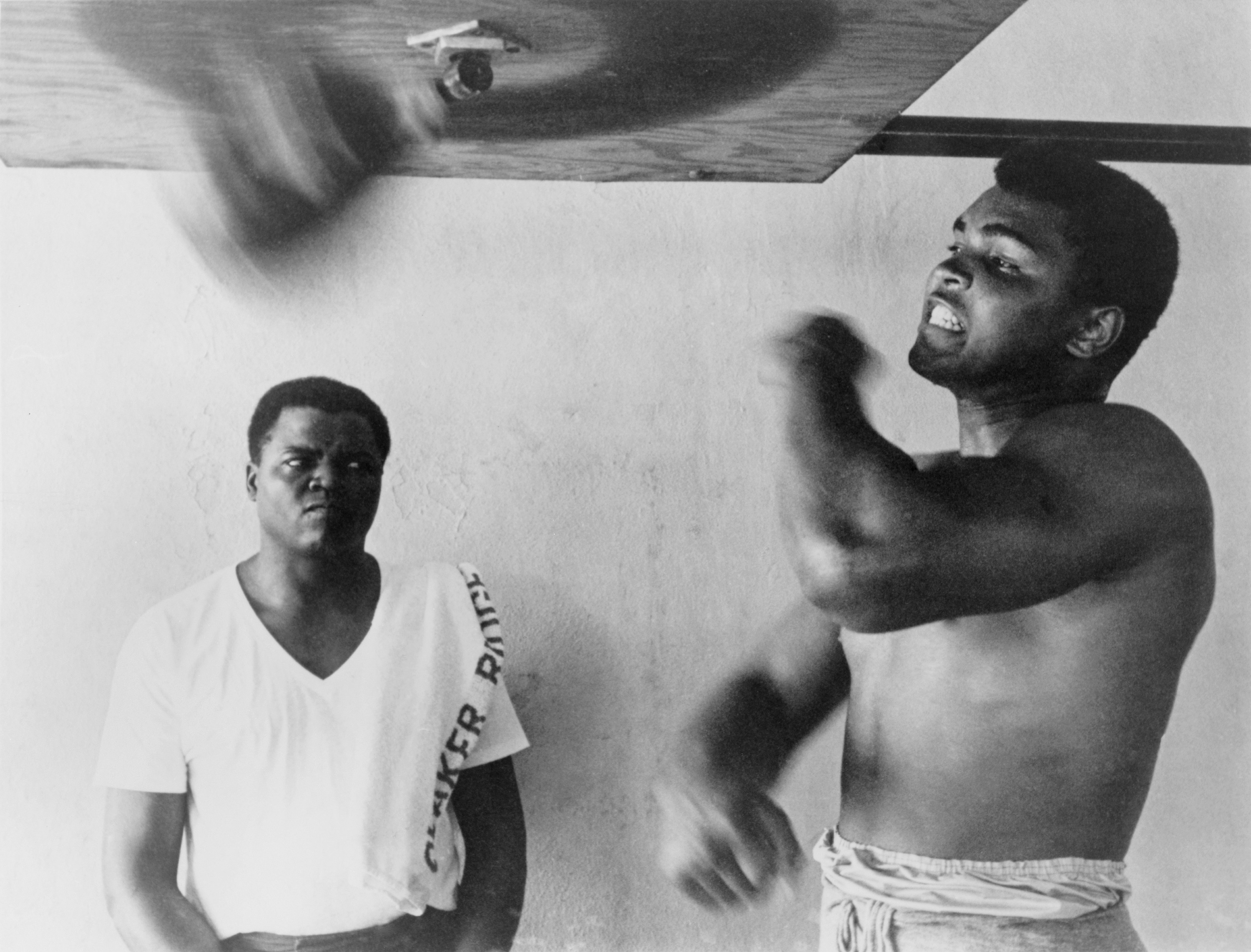 Muhammad Ali, works out on light bag in Miami, Florida. 1965., Image: 101845325, License: Rights-managed, Restrictions: For usage credit please use; Courtesy Everett Collection, Model Release: no, Credit line: Profimedia, Everett