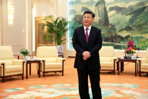 Chinese President Xi Jinping waits for the arrival of US National Security Adviser Susan Rice (not pictured) for their meeting at the Great Hall of the People in Beijing on 25 July 2016. ? / AFP PHOTO / POOL / HOW HWEE YOUNG