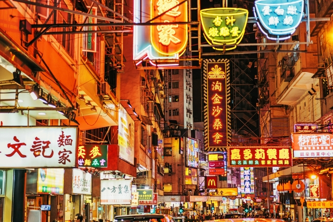 busy Street with signs and traffic in Kowloon, Hong Kong