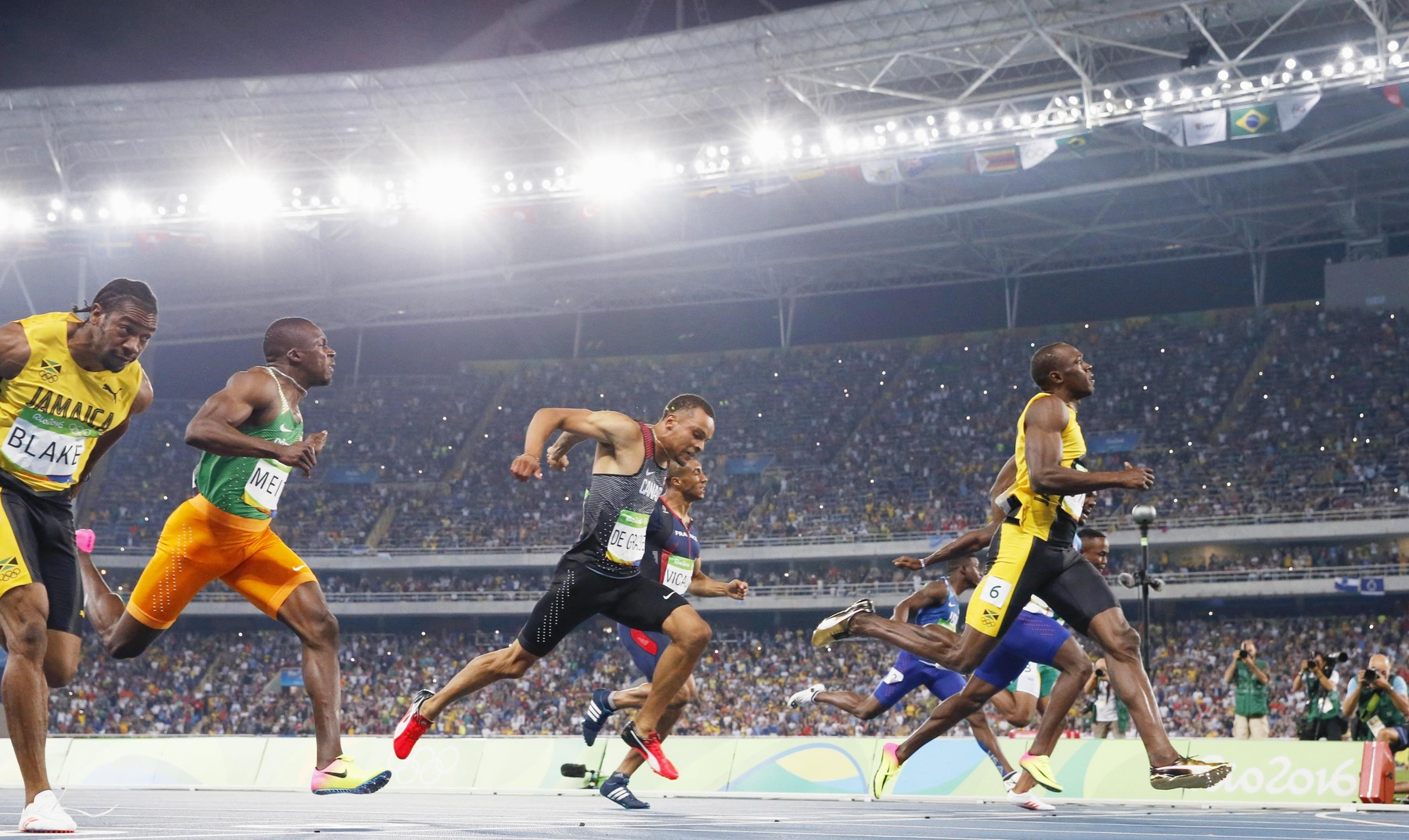 Olympics: Olympics: Bolt completes unprecedented 100m three-peat