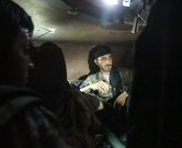 US-backed Kurdish and Arab fighters sit in a military vehicle as they advance into the Islamic State (IS) jihadist's group bastion of Manbij, in northern Syria, on June 23, 2016.  Backed by air strikes by the US-led coalition bombing IS in Syria and Iraq, fighters with the Syrian Democratic Forces (SDF) alliance entered Manbij from the south, a monitoring group said.   / AFP PHOTO / DELIL SOULEIMAN