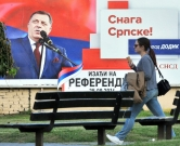 "This photo taken on September 24, 2016 shows a billboard featuring the leader of the Party of Independent Social Democrats Milorad Dodik reading ""Get out on Referendum Day 25.09.2016"" and ""The Power of Srpska"", prior to a referendum vote on January 9 becoming a national holiday, in the western Bosnian town of Banja Luka.  Citizens of Bosnia and Herzegovina's Serb-dominated entity of Republika Srpska will vote on the referendum question ""Should January 9 become a national holiday?"" The referendum remains scheduled for September 25, even after it was disputed by the Peace Implementation Committee in Bosnia and banned by country's Constitutional Court, ramping up tensions in the fragile country. The date is controversial as it marks the proclamation of a ""Republic of Serb people"" in Bosnia three months before the inter-ethnic 1992-1995 war that claimed 100,000 lives. / AFP PHOTO / ELVIS BARUKCIC"