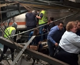 HOBOKEN, NJ - SEPTEMBER 29: Passengers rush to safety after a NJ Transit train crashed in to the platform at the Hoboken Terminal September 29, 2016 in Hoboken, New Jersey.   Pancho Bernasconi/Getty Images/AFP