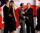CLEVELAND, OH - JULY 21: Republican presidential candidate Donald Trump and his son Donald Trump Jr. embrace as Eric Trump, Lara Yunaska, Tiffany Trump and Vanessa Trump look on on the fourth day of the Republican National Convention on July 21, 2016 at the Quicken Loans Arena in Cleveland, Ohio. Republican presidential candidate Donald Trump received the number of votes needed to secure the party's nomination. An estimated 50,000 people are expected in Cleveland, including hundreds of protesters and members of the media. The four-day Republican National Convention kicked off on July 18.   Joe Raedle/Getty Images/AFP