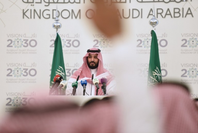 "Saudi Defense Minister and Deputy Crown Prince Mohammed bin Salman gives a press conference in Riyadh, on April 25, 2016. The key figure behind the unveiling of a vast plan to restructure the kingdom's oil-dependent economy, the son of King Salman has risen to among Saudi Arabia's most influential figures since being named second-in-line to the throne in 2015. Salman announced his economic reform plan known as ""Vision 2030"". / AFP PHOTO / FAYEZ NURELDINE"