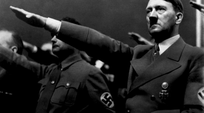 """A picture dated 1939 shows German Nazi Chancellor Adolf Hitler giving the nazi salute during a rally next to """"Deputy Furhrer"""" Rudolf Hess. AFP PHOTO / FRANCE PRESSE VOIR / AFP PHOTO / FRANCE PRESSE VOIR"""