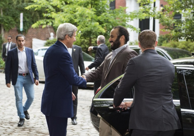 US Secretary of State John Kerry (L) greets Saudi Deputy Crown Prince Mohammed bin Salman outside Kerry's residence prior to their meeting on June 13, 2016, in Washington, DC. / AFP PHOTO / MOLLY RILEY