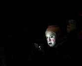 """A clown looks at his phone during the second day of the XXI Convention of Clowns, at the Jimenez Rueda Theatre, in Mexico City on October 18, 2016.  Latin American clowns hold their 21st annual conference in Mexico City from October 17 through 20. The 'lurking clown' phenomenon as a wave of hysteria about sightings of """"creepy"""" or """"killer"""" clowns that sweeps the United States and European nations will be discussed. / AFP PHOTO / PEDRO PARDO"""