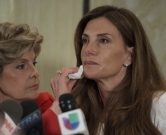 Karena Virginia, along with attorney Gloria Allred, speaks at a news conference October 20, 2016 in New York. Virginia, a yoga teacher and life coach from New York, came forward for the first time on October 20, 2016 to accuse Republican presidential nominee Donald Trump of engaging in inappropriate sexual conduct which occured in 1998. / AFP PHOTO / DON EMMERT