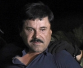 """(FILES) This file photo taken on January 08, 2016 shows drug kingpin Joaquin """"El Chapo"""" Guzman escorted into a helicopter at Mexico City's airport following his recapture during an intense military operation in Los Mochis, in Sinaloa State.  A Mexican judge approved on October 20, 2016 drug lord Guzman's US extradition, official sources announced. / AFP PHOTO / ALFREDO ESTRELLA"""