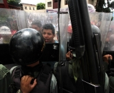 Opposition activists clash with National Guard members during a protest in San Cristobal, state of Tachira, Venezuela on October 26, 2016. Venezuela's opposition ratcheted up the pressure on President Nicolas Maduro at mass protests, announcing plans for a general strike, a new march and a legislative onslaught       / AFP PHOTO / George Castellanos
