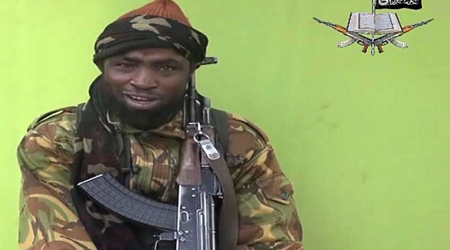 """A screengrab taken on May 12, 2014, from a video released by Nigerian Islamist extremist group Boko Haram and obtained by AFP shows a man claiming to be the leader of Nigerian Islamist extremist group Boko Haram Abubakar Shekau. Boko Haram released a new video on claiming to show the missing Nigerian schoolgirls, alleging they had converted to Islam and would not be released until all militant prisoners were freed.  Abubakar Shekau speaks on the video obtained by AFP for 17 minutes before showing what he said were about 130 of the girls, wearing the full-length hijab and praying in an undisclosed rural location. A total of 276 girls were abducted on April 14 from the northeastern town of Chibok, in Borno state, which has a sizeable Christian community. Some 223 are still missing. AFP PHOTO / BOKO HARAM  RESTRICTED TO EDITORIAL USE - MANDATORY CREDIT """"AFP PHOTO / BOKO HARAM"""" - NO MARKETING NO ADVERTISING CAMPAIGNS - DISTRIBUTED AS A SERVICE TO CLIENTS / AFP PHOTO / BOKO HARAM / HO"""