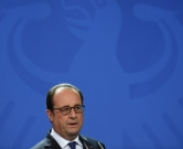 French President Francois Hollande speaks during  a press conference with German chancellor Angela Merkel (unseen) after a meeting of the leaders of Russia, Ukraine, France and Germany on a new push for peace in eastern Ukraine at the chancellery in Berlin, on October 19, 2016. / AFP PHOTO / STEPHANE DE SAKUTIN