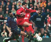 Wimbledon's Vinnie Jones (L) tackles Liverpool's Jamie Redknapp during their Premiership clash at Anfield. Liverpool defeated WImbledon 2-0. UK   OUT / AFP PHOTO / PA / STR