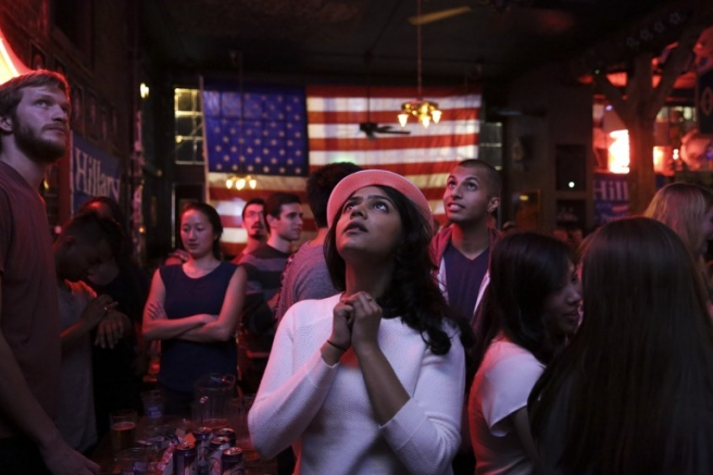 Sri Vasamsetti, 22, of Seattle and a supporter of Democratic presidential candidate Hillary Clinton, watches televised coverage of the US presidential election at the Comet Tavern in the Capitol Hill neighborhood of Seattle, Washington on November 8, 2016. /