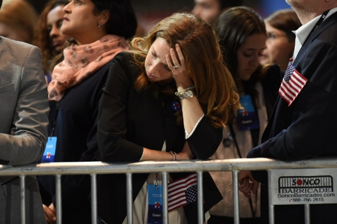 A supporter of US Democratic presidential nominee Hillary Clinton reacts as elections returns are reported during election night at the Jacob K. Javits Convention Center in New York on November 8, 2016. Clinton will hold her election night event at the convention center. /