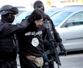 "This handout  photo obtained from Bosnia and Herzegovina's State Agency for Investigations and Protection (SIPA) on April 15, 2015 shows SIPA officers conducting an actual arrest in the greater Sarajevo area, on April 15, 2015. Police in Bosnia arrested a man on terrorism charges for allegedly meeting with Islamic State jihadists in Syria. The suspect, named as Kenan Krso, was suspected of ""several activities linked with terrorism,"" a spokesman for the public prosecutor's office told reporters.  RESTRICTED TO EDITORIAL USE - MANDATORY CREDIT  "" AFP PHOTO / BOSNIA AND HERZEGOVINA STATE AGENCY FOR INVESTIGATION AND PROTECTION. ""  -  NO MARKETING NO ADVERTISING CAMPAIGNS   -   DISTRIBUTED AS A SERVICE TO CLIENTS "" / AFP PHOTO / SIPA / HO"