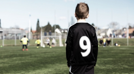 Young boy and his youth team during a kids soccer match outdoors on green soccer pitch., Image: 271971867, License: Royalty-free, Restrictions: , Model Release: no, Credit line: Profimedia, Stock Budget